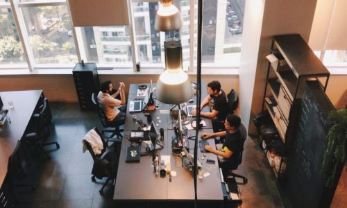 high-angle-view-of-people-working-in-office_t20_wabeXr