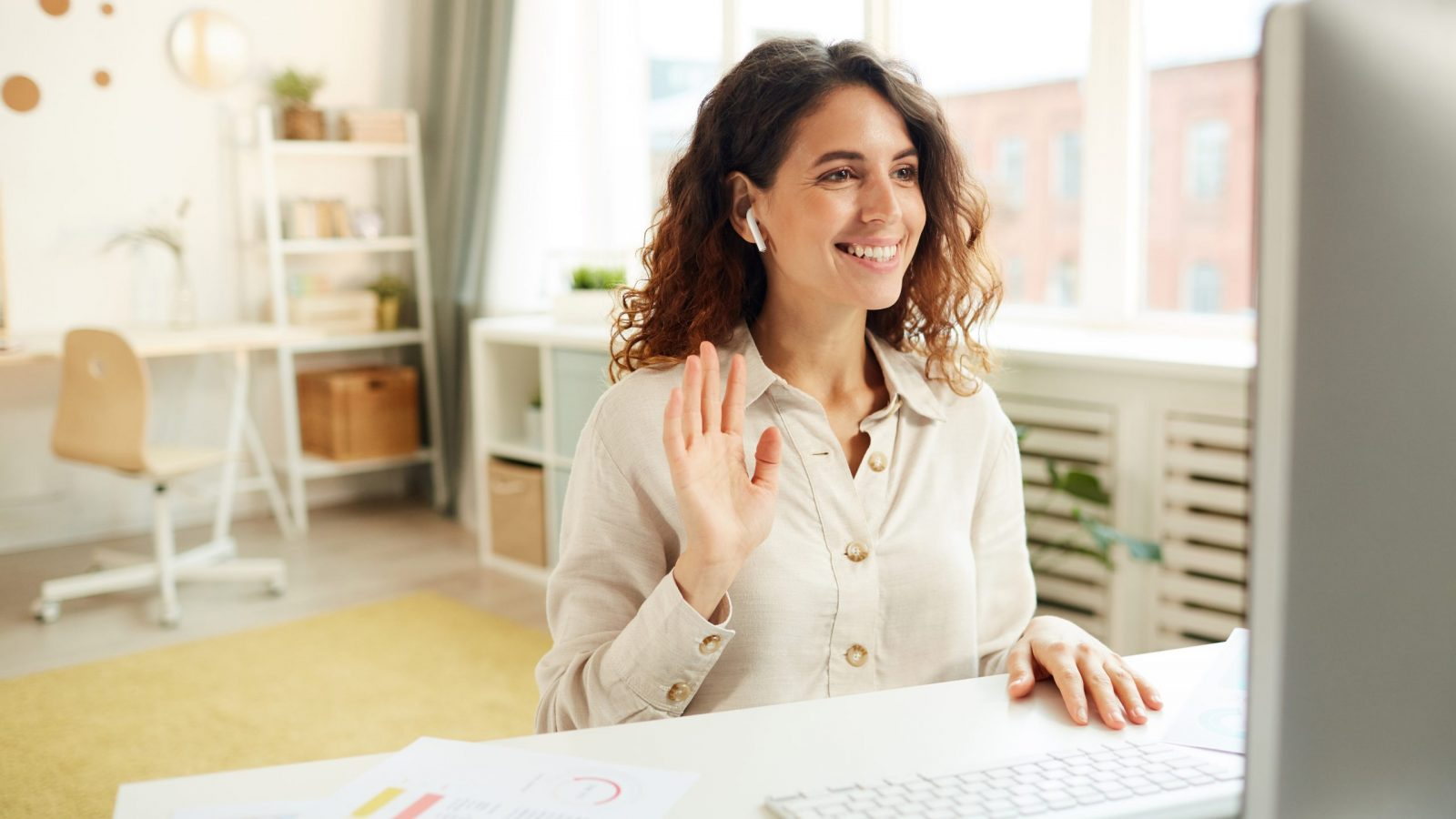 Horizontal medium portrait of young adult female manager taking part in online meeting while staying home